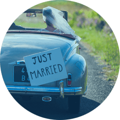 Couple in car with just married sign